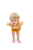 Three year old boy with unhappy expression. Three year old boy with a naughty expression on his face. Intentional drop shadow  at feet Royalty Free Stock Photography