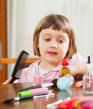 Three year old child  brushing  hair. Little girl brushing her hair Royalty Free Stock Photo