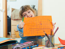 Three year old child drawing on paper Royalty Free Stock Images