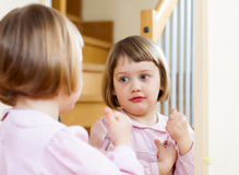 Three year old child  front of  mirror Stock Images