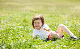 Three year old child playing at grass royalty free stock images