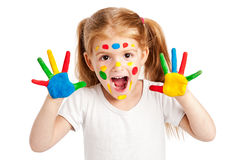 Three Year Old Gilr With Brightly Painted Hands. Funny young girl with brightly painted hands. Isolated on white background Royalty Free Stock Photography