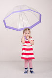 Three year old girl raised her umbrella Stock Image