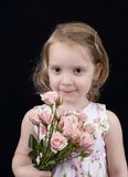 Three year old girl with roses. Little girl with flowers Royalty Free Stock Images