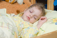 Three year old girl sleeping in her crib Royalty Free Stock Photo