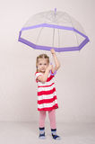 Three year old girl standing with umbrella Royalty Free Stock Photography