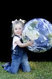 Three Year Old Holding Up the Earth Stock Photo