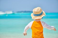 Three year old toddler boy on beach royalty free stock photography