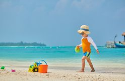 Three year old toddler playing on beach royalty free stock image