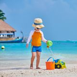 Three year old toddler playing on beach royalty free stock photos