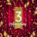 Three years anniversary golden signboard in spotlight on red curtain background and golden confetti. Stock Photography