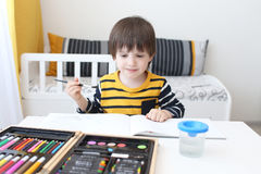 Three-years boy is painting Stock Photo