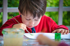 Three years old boy painting with brush Royalty Free Stock Photography