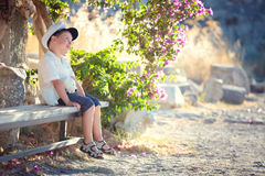 Three years old boy sitting on bench Royalty Free Stock Image
