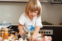 Three years-old child cooking Stock Photography