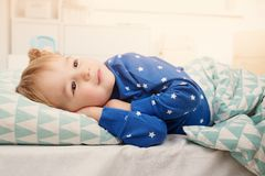 Three years old child lying in bed Stock Photo