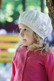 Three years old girl portrait wearing white broderie anglaise fabric beret Royalty Free Stock Image