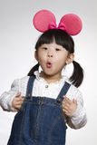 Three years old girl wearing Mickey Mouse ears studio shot Stock Images