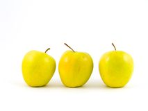 Three yellow apples. On white royalty free stock photos
