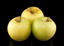 Three yellow apples on black background Royalty Free Stock Photo