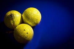 Three yellow balls Christmas Royalty Free Stock Photos