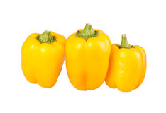 Three yellow bell peppers isolated against white Stock Images