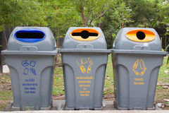 Three yellow bins place in the public garden Royalty Free Stock Photography