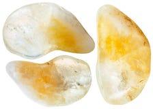 Three yellow citrine gemstones isolated on white Stock Images