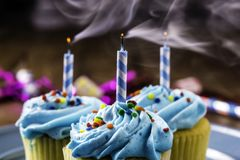 Cupcakes with Blue Icing and Sprinkles Stock Image