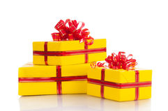 Three yellow gift on a white background Royalty Free Stock Images