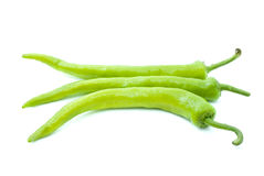 Three yellow-green chili peppers. Isolated on the white background Stock Images