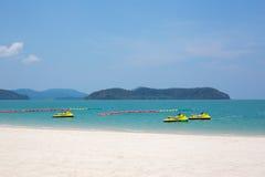 Three yellow jet ski in the water Royalty Free Stock Photos