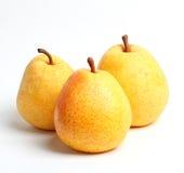 Three yellow juicy pears Closeup Royalty Free Stock Photo