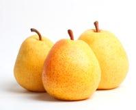 Three yellow juicy pears Closeup Royalty Free Stock Photos