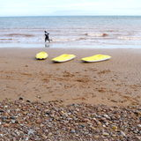 Three yellow kayaks Stock Images