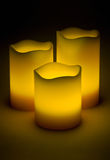Three yellow LED candles. In the dark Stock Photo