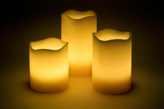 Three yellow LED candles. In the dark Royalty Free Stock Images
