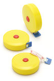 Three yellow measuring tapes Royalty Free Stock Photography