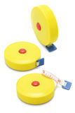 Three yellow measuring tapes Royalty Free Stock Photo