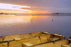 Three yellow metal boats tied together on calm lake at dawn unde Royalty Free Stock Photography