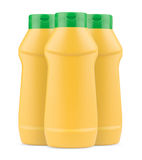 Three yellow mustard plastic bottles with no label and green cap. Front view of three yellow mustard plastic bottles with no label and green cap isolated white stock images