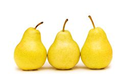 Three yellow pears isolated. On the white Royalty Free Stock Photos