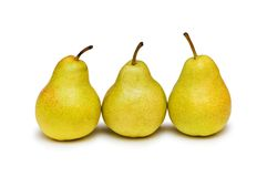 Three yellow pears isolated Stock Images