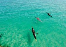 Three Yellow and Pink Kayak Stock Images