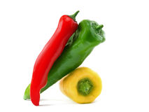 Three yellow red green chillies stock image