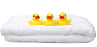 Three Yellow Rubber Ducks in a Row Stock Images