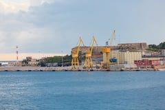 Three Yellow Shipping Cranes Stock Photography