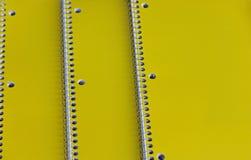 Three Yellow Spiral Notebooks Stock Photos
