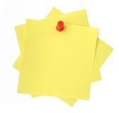 Three yellow sticky notes. Thumbtacked to white background Stock Photo
