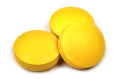 Three yellow tablets Stock Image